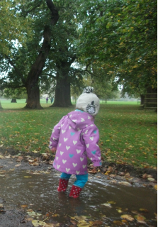 Jumping in a big puddle at Burghley