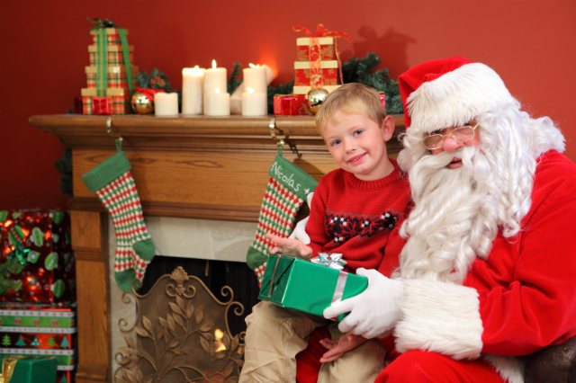 Sitting on Santa's knee. ©iStock.com/morganl