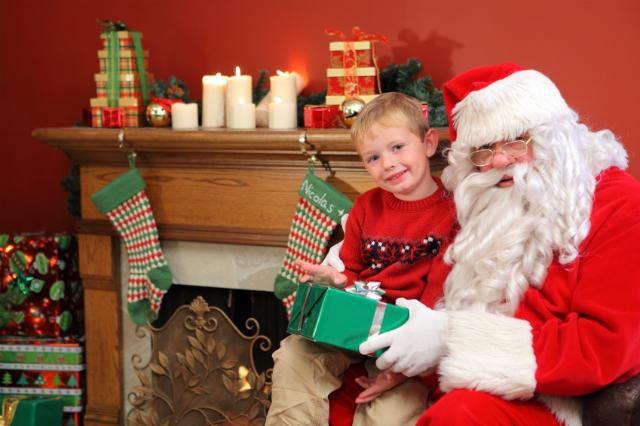 Sitting on Santa's knee. ©iStock.com/morganl