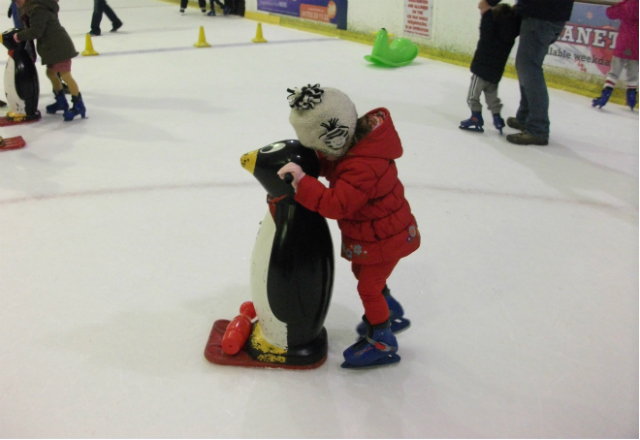 Toddler ice skating