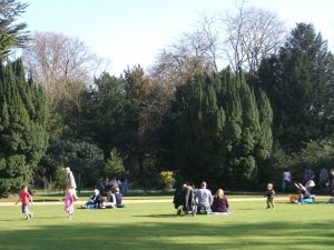 Families have a picnic at Anglesey Abbey.