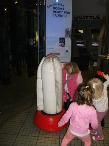 The girls build a foam space rocket